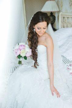 Bridal haircut with locks and long veil