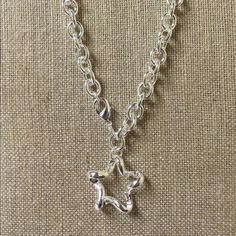 Silver Star Large Link Necklace Beautiful silver large link necklace with a gorgeous star and finished with a lobster clasp. The necklace measures about 17 inches and the star measures a little over 1 inch at it's widest points. KSAR Jewels Jewelry Necklaces