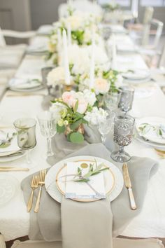 soft gray and ivory table setting with candles and flowers | Photography: Mike Larson