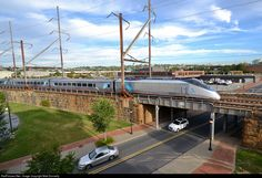 Acela rounding the bend into downtown Wilmington: AMTK 2034 Amtrak Bombardier/Alstom Acela Express Trainset at Wilmington, Delaware by Matt Donnelly