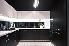 Interior of modern luxury kitchen with black cabinets
