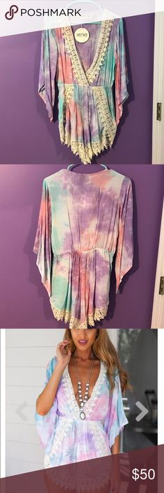 Adorable Romper Jumpsuit! 🌟NEVER WORN!!!!🌟 Still has the tags on it! Such a cute romper perfect for the summer! I ordered it but it doesn't fit me, i wish it did i would for sure keep it! :) Xenia Dresses Mini