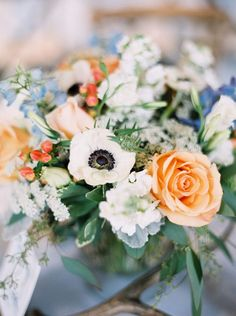 Moonlight Lodge Montana Wedding featured on Grey Likes Weddings | Pastel table florals with pops of color | Peach, blue & white floral arrangement | Montana Wedding Photographers | Photo by Orange Photographie #orangephotographie