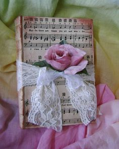 Shabby Chic Altered book.  There is some very nice sheet music scrapbook paper out there.  Also, an actual song sheet could be used.  Antique the edges after you glue it on the book.  It looks like the binder is pretty worn.  You could sand this down some, paint it, and antique it.