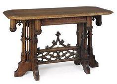 A VICTORIAN GOTHIC REVIVAL OAK CENTRE TABLE