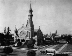 (1876)* - Exterior view of the Presbyterian Church on the northwest corner of Colorado Street and Garfield Avenue, in Pasadena, in 1876. Tower was blown down in the windstorm of 1888. A trolley pulled by horses is shown in the foreground.