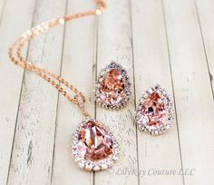 Genuine Swarovski Crystal Pear Drop Earrings, Bracelet and Necklace - in ROSE GOLD SETTINGS!! ✿✿✿EARRINGS AND NECKLACE ARE PRICE INDIVIDUALLY AND ARE DISCOUNTED WHEN PURCHASED TOGETHER- PLEASE CLICK THE DROP DOWN BOX ABOVE FOR PRICING INFO!!✿✿✿  CRYSTALLIZED™ BY SWAROVSKI™ Crystal Pear shaped Fancy Stones™, set inside ROSE GOLD plated rhinestone halo bezel settings  Color in Photo above is Vintage Rose  ✿Necklace - 18mm CRYSTALLIZED™ BY SWAROVSKI™ Crystal Pear shaped Fancy Stone™ set inside…