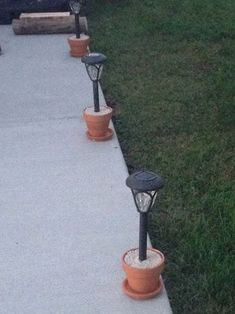 Problem: Solar lights staked in yard are difficult to mow weed eat around. Solution: Terra cotta flower pots a bag of quick-krete. Mix concrete according to the package directions. Scoop into flower pot immediately put light into the center (remove the Backyard Projects, Outdoor Projects, Backyard Patio, Garden Projects, Backyard Landscaping, Landscaping Ideas, Backyard Ideas, Cheap Patio Ideas, Backyard Seating
