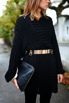 black sweater with gold belt