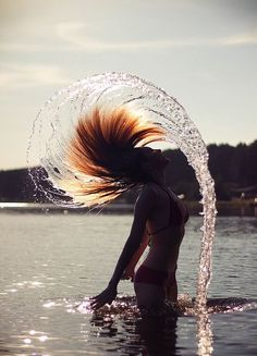 I whip my hair back and forth! XP Really, this picture is awesome. I LOVE the lighting and the way the water is. :D