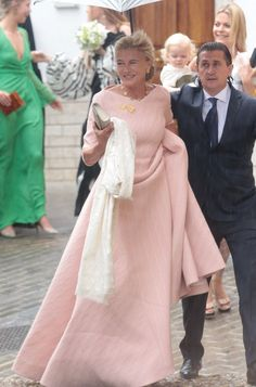 Yesterday, Lady Charlotte Wellesley married financier Alejandro Santo Domingo in a Catholic ceremony in Íllora, Spain. The bride wore an off-the-shoulder Emilia Wickstead wedding dress and a cathedral-length veil accented with embroidered polka dots.