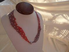 Magie Céleste, création pour le concours E-Beads Compétion 2016 dont le thème était Nuit Céleste. Ce collier est tissé en perles japonaise Toho et le fermoir est en argent rhodié. Le prix de ce bijou est 129 €