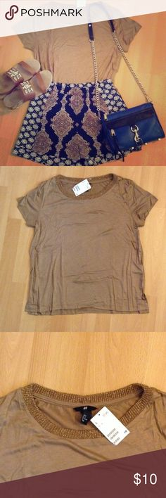 H&M NWT golden brown shirt ✨ H&M brown shirt with gold knit trim. Rayon material - very soft! Size small. Can be styled so many ways, a great neutral shirt! Never been worn, mint condition! H&M Tops Tees - Short Sleeve