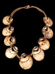 India | Necklace from Nagaland made up of of peices of shell cut from Turbinella sp, from the Bay of Bengal, cowrie shells and ceramic beads on a cotton cord | ca. late 20th century