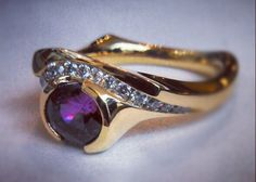 Grape Sapphire Ring:  diamonds and 18k gold