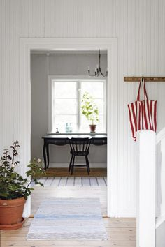 Graphic designers Paul Kulhorn and Eva Liljefors' summer home via Lantliv. Swedish Cottage, Swedish House, White Cottage, Cottage Style, Scandinavian Home Interiors, Red Interiors, Entry Stairs, Interior And Exterior, Interior Design