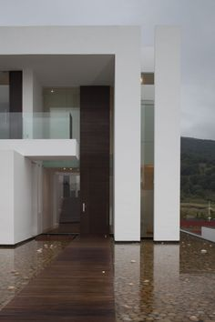 White Corners Sustainable House Integrating Well Defined Volumes by Almazán Arquitectos