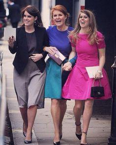 Princess Eugenie (L), Princess Beatrice (R) and their mother, Sarah Ferguson between them.