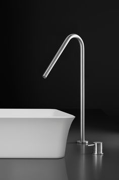 Stainless steel single-hole, deck-mount basin spout Italian-made, stainless steel sink faucet with unique swan-neck spout, designed to coordinate with countertop basins, particularly in an offset application. Pair with deck-mount or wall-mount single-lever handle trim set.