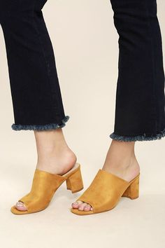 The Cecily Mustard Suede Peep-Toe Mules will fit perfectly into your wardrobe! A chic mule silhouette is finished with a peep-toe upper, slide-on design, and block heel.