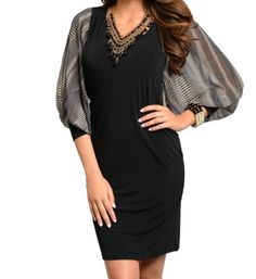 Oversized cuffed blouson style sleeve dress with low u-shaped/cut out back