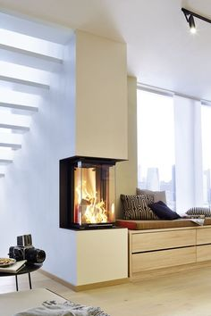 A modern fireplace from BRUNNER that adapts perfectly to its surroundings. - A modern fireplace from BRUNNER that adapts perfectly to its surroundings. A cozy bench with practi - Home Fireplace, Modern Fireplace, Fireplace Design, Fireplace Ideas, Interior Design Boards, Interior Design Living Room, Easy Home Decor, Home Decor Trends, Home Decoration