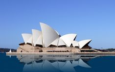 """See 3633 photos and 36 tips from 15046 visitors to Sydney. """"Go to Sydney in January. It's hot, but Sydney lives for the Summer. Famous Buildings, Famous Landmarks, Famous Structures, Sidney Opera, Places Around The World, Around The Worlds, Jorn Utzon, Templer, Sydney Harbour Bridge"""