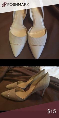 "Calvin Klein pumps Bone color with gold detail size 7 2"" pump. Worn once, no box. Comes from smoke free home Calvin Klein Collection Shoes Heels"