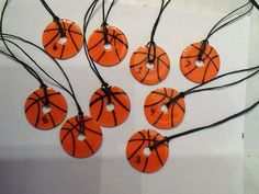 """Basketball washer necklace - I will try to attach the original pin that had the washer jewelry idea. 1 1/12"""" washers, orange scrapbook paper, ModPodge matte, a Sharpie, ModPodge dimensional, and hemp. Made these for my girls basketball team"""