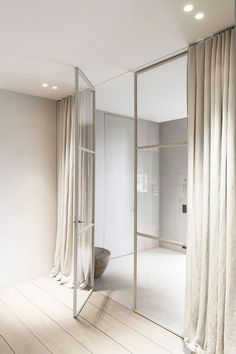 AT- thought: what about framing the doors with drapes? If we ended up going more French door-y--SB