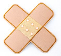 Band-aid cross iron-on patch for kids clothes by MuddyMouseIronons