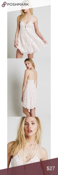 NWT Free People Slip Dress Adorable brand new, with tags free people dress. Can easily be worn for a variety of occasions. The color is a very pale pink and looks almost white like pictured. The straps are on the longer side for a medium (I tired it on) but can easily be tailored to be shorter if need be. Size medium. Free People Dresses Mini