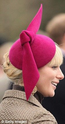 Zara Phillips wearing a raspberry Philip Treacy hat.