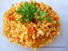 Turkish bulgur wheat pilaf ( a great alternative to rice, to make it more interesting I used red pepper paste instead of the tomato paste. Additionally, i added the fresh tomato after cooking to preserve the texture and add a freshness to the dish. It was fantastic! Perhaps spelt could be substituted for the gluten intolerant?