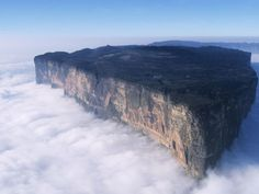 Mount Roraima, Venezuela. This tabletop mountain is one of the oldest mountains on Earth, dating back two billion years when the land was lifted high above the ground by tectonic activity. The sides of the mountain are sheer vertical cliffs, with several waterfalls, making it nearly impossible to climb.