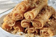 Diples Greek sweets with honey and walnuts Greek Sweets, Greek Desserts, Greek Recipes, Beignets, Greek Fries, Mediterranean Desserts, Cyprus Food, Honey Dessert, Delicious Desserts