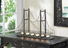 Golden Gate Bridge Candle Holder - This Golden Gate Bridge Candle Holder is a candlelit accessory and a conversation starter, all in one! This charming candle holder features six fluted clear glass candle cups set on the framework of a suspension bridge. 6 Candles, Candle Lanterns, Tea Light Candles, Tea Lights, Candle Lighting, Candle Cups, Tealight Candle Holders, Candleholders, Candlestick Holders