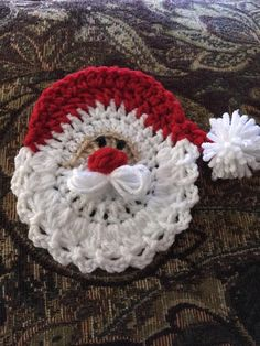 Made by Debbie Lagant : Crocheted a santa Face can be used for a magnet or ornaments or on gifts or pin