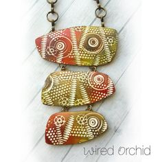 Polymer Clay Necklace Jewelry featuring an Abstract Design in Rust Red, Olive Green and White