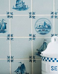 Hand-shaped and hand-painted Delft tiles, from the Royal Makkum line at Country Floors, introduce another blue note.   - HouseBeautiful.com