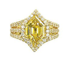 A COLOURED DIAMOND AND DIAMOND RING   Set with an hexagonal-shaped fancy vivid yellow diamond weighing 3.24 carats, to the micro pavé-set diamond three-band shoulders, mounted in 18k gold
