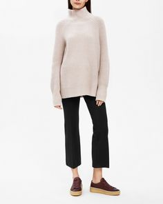 Soft yet strong in shape, our sculptural sweater is made from a wool-cashmere blend with raglan sleeves and a ribbed neck. It's slightly longer, reaching below the hip.<br><br> • 95% wool 5% cashmere<br> • Sculptural shape<br> • Below hip length<br>
