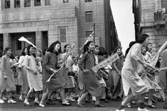 1949- Shanghai / After the War, End of an Era / Communist students demonstrate against the black market. Behind them is the Soon Bank, owned by Chiang Kai-shek's father-in-law. Photo: Henri Cartier Bresson