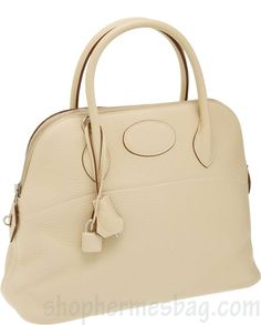 "http://www.shophermesbag.com/ Hermes Birkin 31cm Parchment Clemence Leather Mou Bolide Bag with Palladium Hardware Excellent Condition12"" width x 9.5"" height x 5"" depth Missing shoulder strap."