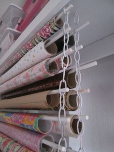Paper and Ribbon Storage Rolls of wrapping paper stored on dowels suspended by metal chains.Rolls of wrapping paper stored on dowels suspended by metal chains. Sewing Room Organization, Craft Room Storage, Organization Hacks, Storage Ideas, Craft Rooms, Ribbon Organization, Diy Storage, Origami Rose, Origami Ball