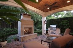 Covered porch (for townhome/small back yard with stained cedar tongue and groove ceiling; Free-standing gas log masonry fireplace with raised stone hearth; Fire Magic gas grill with barbeque/rotisserie/heat searing capabilities set into food prep island with slab counter and stainless steel locker below; Ceiling mounted speakers; Two ceiling fans; Recessed lighting; Two column-mounted gas lamps
