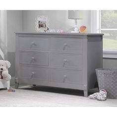 A smart way to add storage to your child's room and a great compliment to the Berkley Convertible Crib (sold separately). Timeless design and quality construction come together to provide a great storage solution for the years to come. Includes 6 ample sized drawers offering plenty of storage. Features stylish front legs and a durable gray finish. Meets all ASTM and CPSC Safety Standards. JPMA Certified.<br><br>The Sorelle Berkley Double Dresser - Gray Features:<br><...