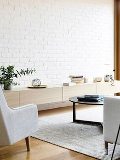 An exposed brick wall in a room doesn't always mean industrial. Moreover if we talk about the specific white brick wall, the style and design it suits will be way more than just one kind. The range is wide as . Brick Painted White, Painted Brick Walls, White Brick Walls, Exposed Brick Walls, Brick Feature Wall, Feature Wall Living Room, Living Room White, White Rooms, Feature Walls