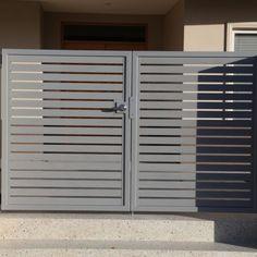 Silver Pearl Electric Access Gate with Intercom Modern Iron Gate Designs, Iron Main Gate Design, Gate Wall Design, House Main Gates Design, Front Gate Design, Door Design, Home Grill Design, Grill Gate Design, Steel Railing Design