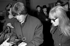 John Lennon and his wife Cynthia during passport control at Zurich Airport | Tages-Anzeiger